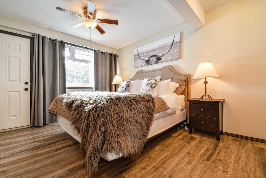 The main bedroom with a queen bed