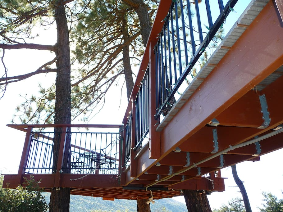 Cross over an amazing floating bridge high above the Forest our Treehouse with Mountain & lake view.