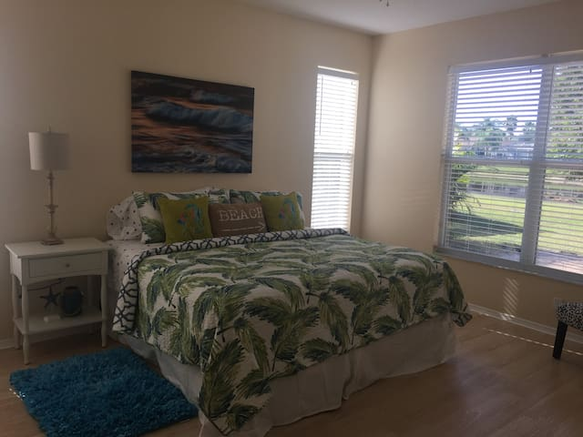 Master bedroom with king size bed over looking lake area