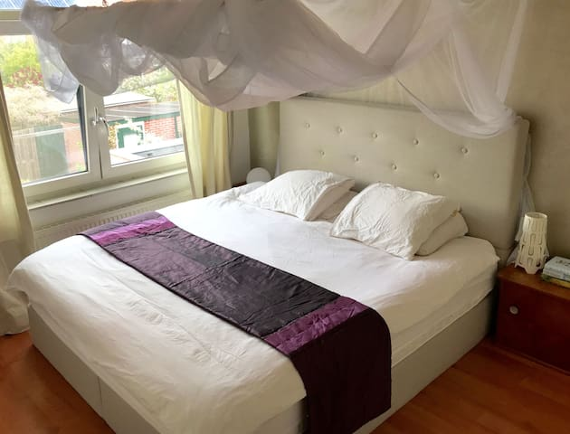 Main bedroom with double bed and 100% cotton bedlinen
