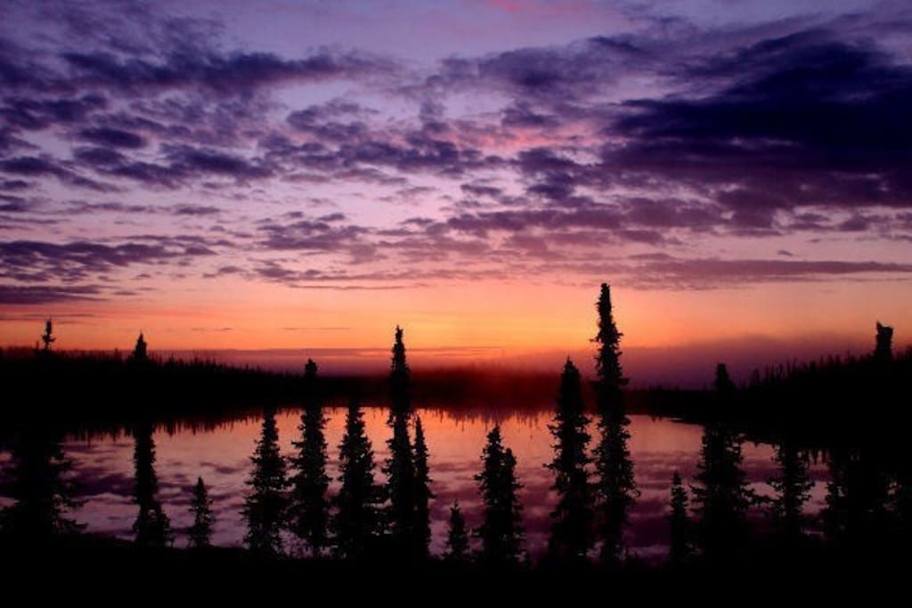 This is the actual view out your living room window at sunrise each morning. Only 10-minutes to town yet, you are in the real Alaskan wilderness. Owned and operated by a nature photographer.
