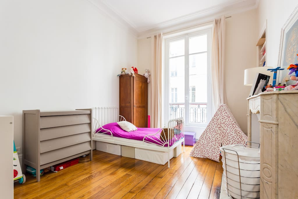 The kids room with one single bed and one crib
