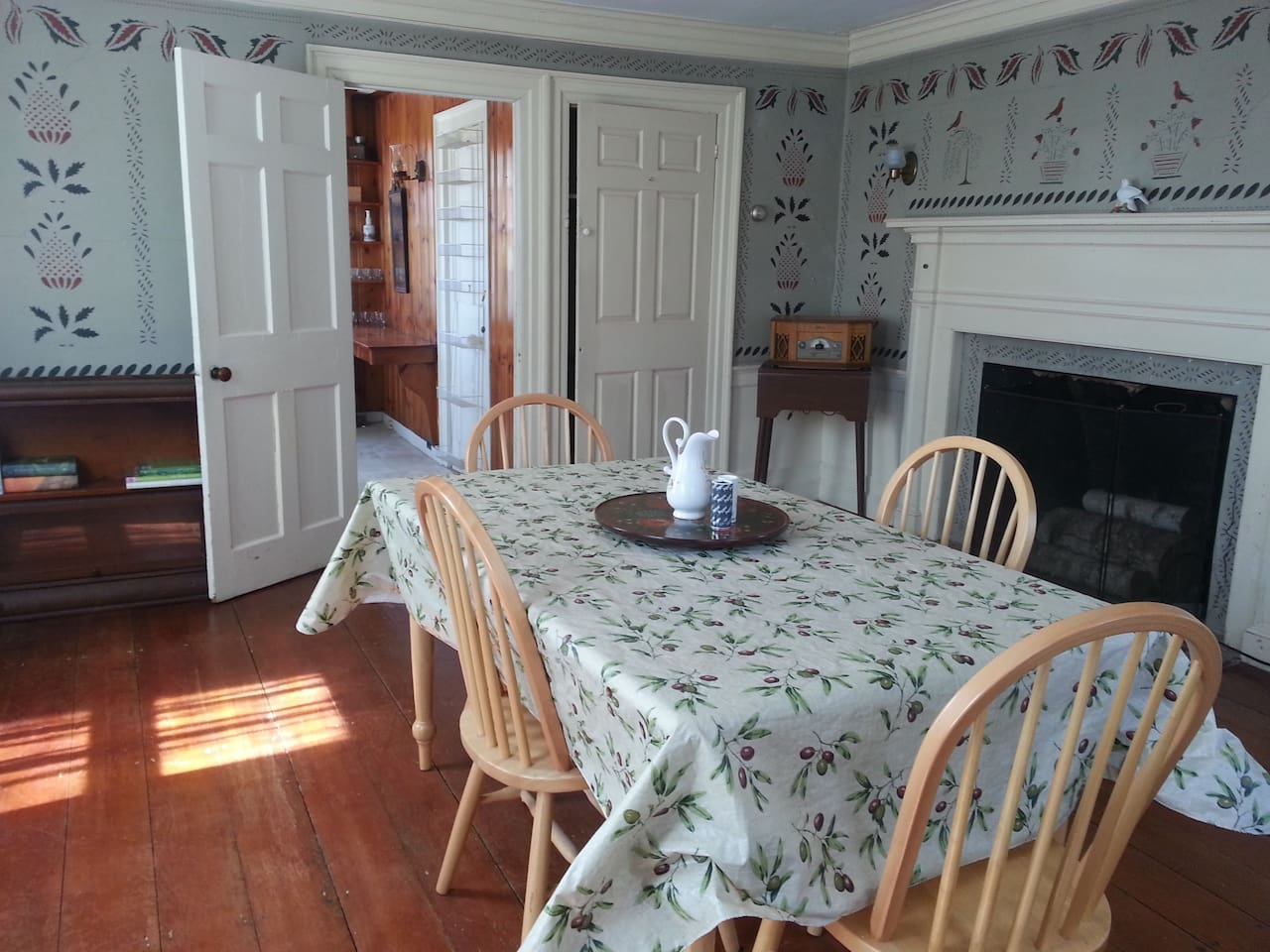"The dining area is located off the kitchen. It was originally used as the ""parlor"" where visitors were hosted by the family."