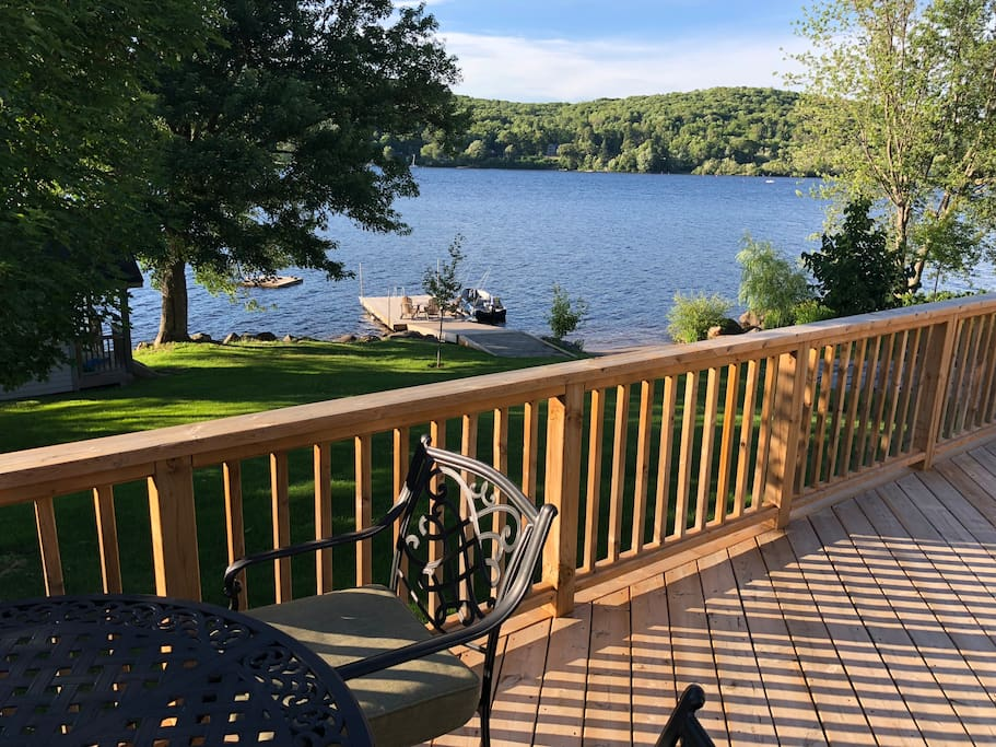 Actual view of lake from guest cottage deck, showing Little Doe Lake and dock for your use