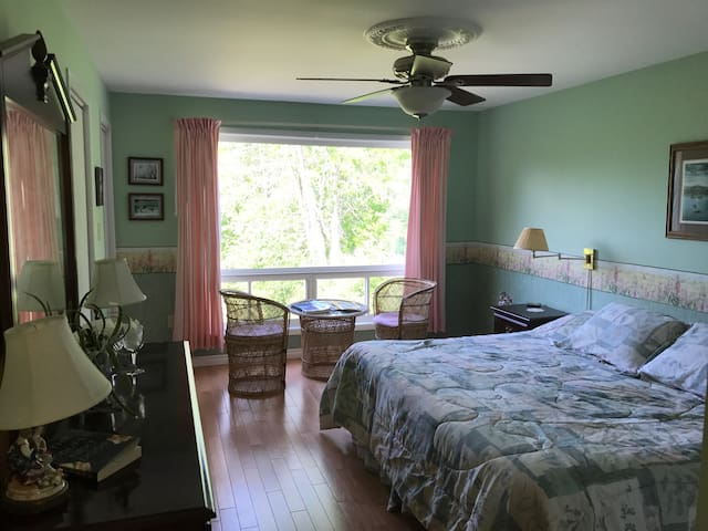 King size bed, large bedroom, view of ponds, shared washroom