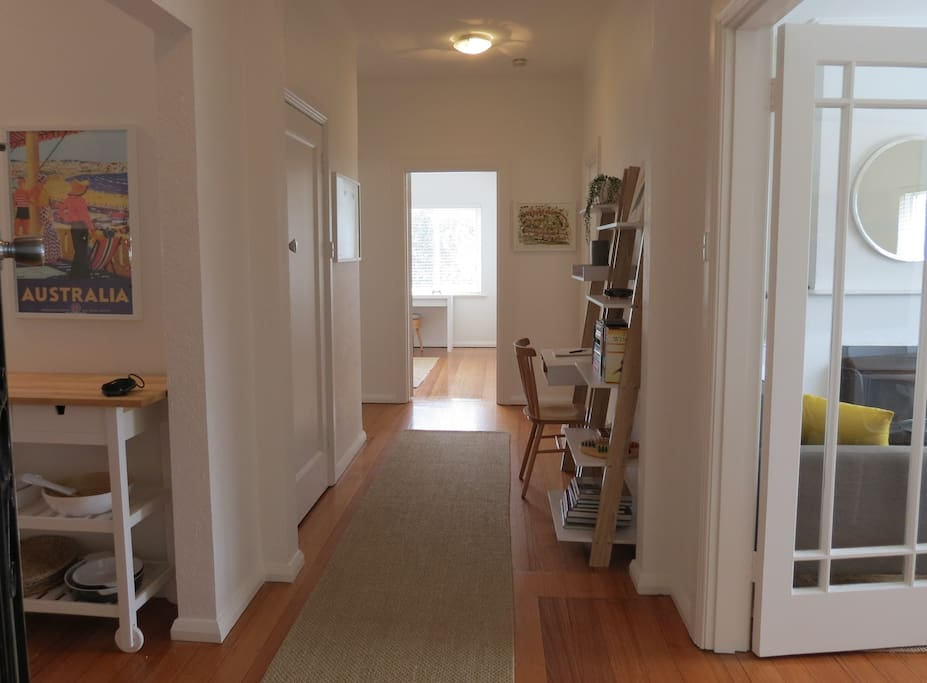 ENTRANCE. The wide central hallway has a workstation and opens on to the the kitchen, living room, bedrooms and bathroom.