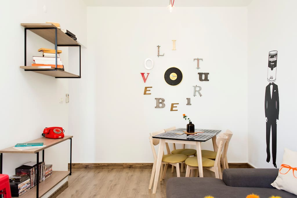 It's a small flat, yet made with lot of love. in the small living space you will enjoy a big comfy sofa, A TV which is not spotted in the photos :)
