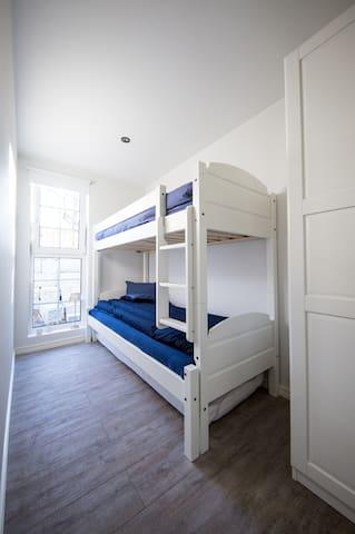Calm bedroom with classic Norwegian family bunk...