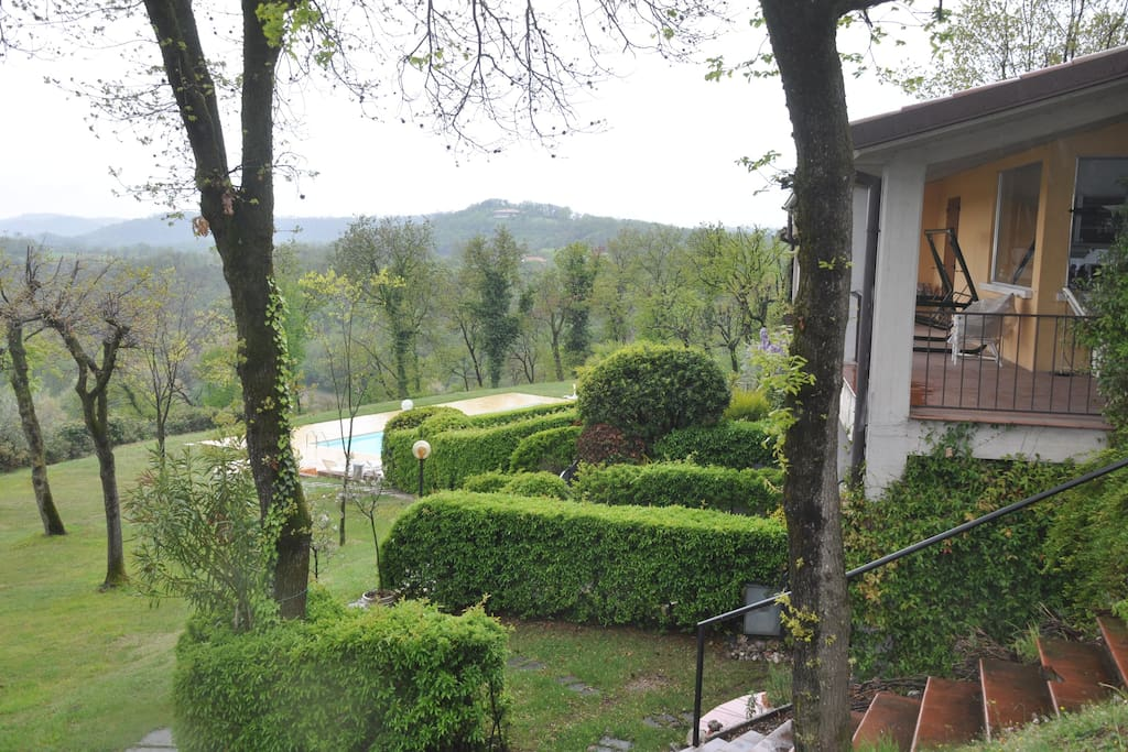 View of the swimming pool and of the gardens of the residence in Winter. External patio of the house with the swing.