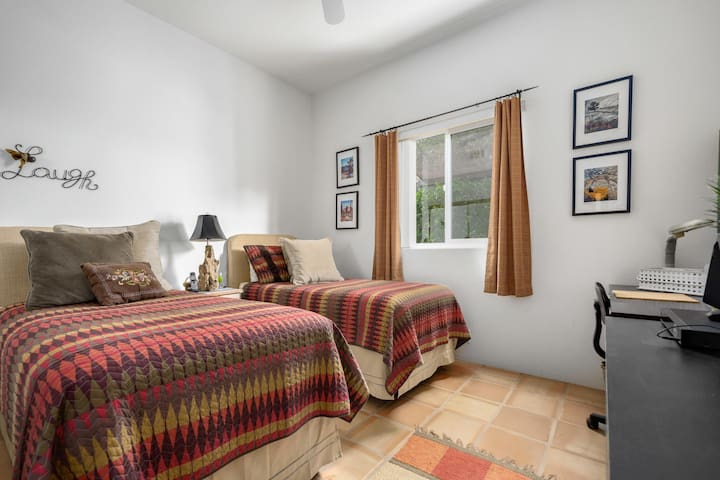 Guest room with 2 twin beds and a desk