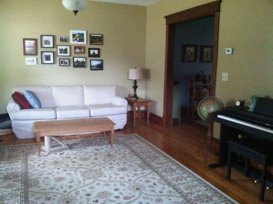 Living room provides ample seating and lots of light