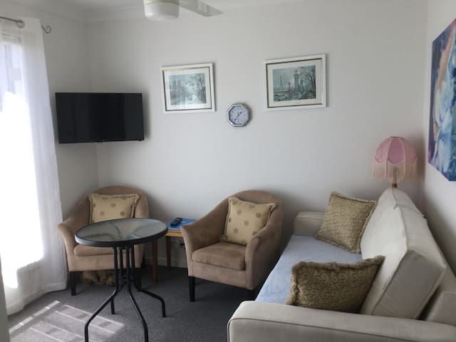 Personal private sitting area with eat in facilities, 32in smart tv. kitchenette and bar fridge, facilities for takeaway or microwave able food.
