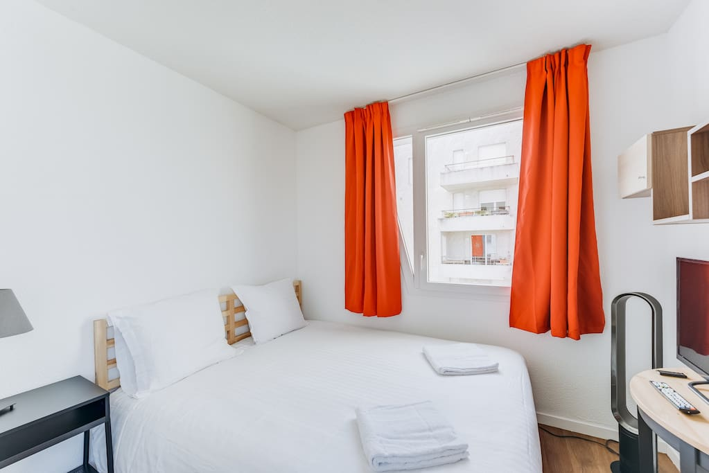 Bright living room with a double bed