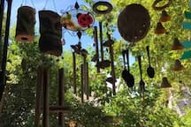 A kind of whimsical Music Show for the Soul ;) Guests tell Me they feel so comfortable, they invite their friends or associates to join them for a Meal or a Visit in this Delightful Patio environment.