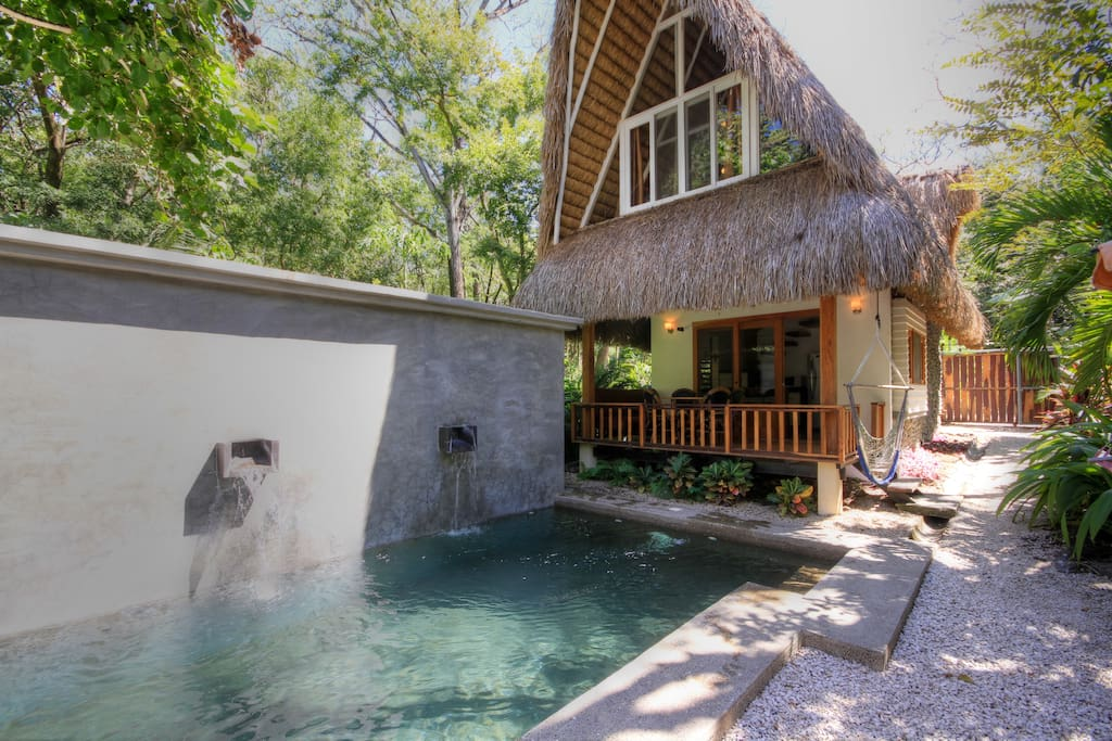 Sacred Spaces are two Balinese Style Homes with a shared pool. Pool View is the home with a patio facing the pool. For info on the Jungle View Home, search Sacred Spaces Jungle View