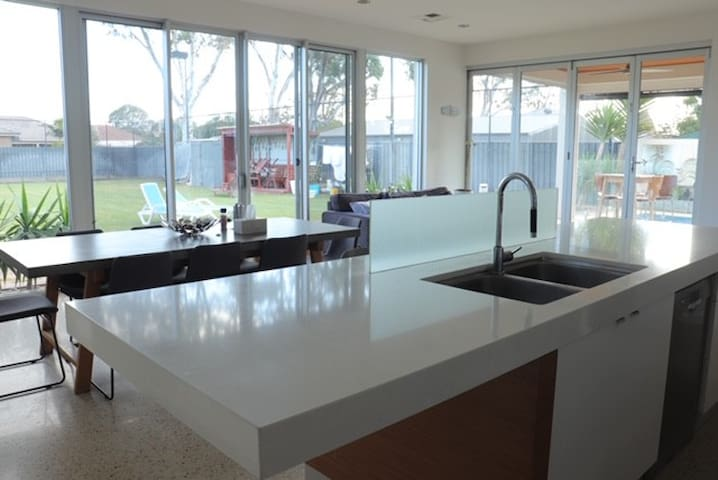 looking out to back yard over the kitchen and open plan dining and living area