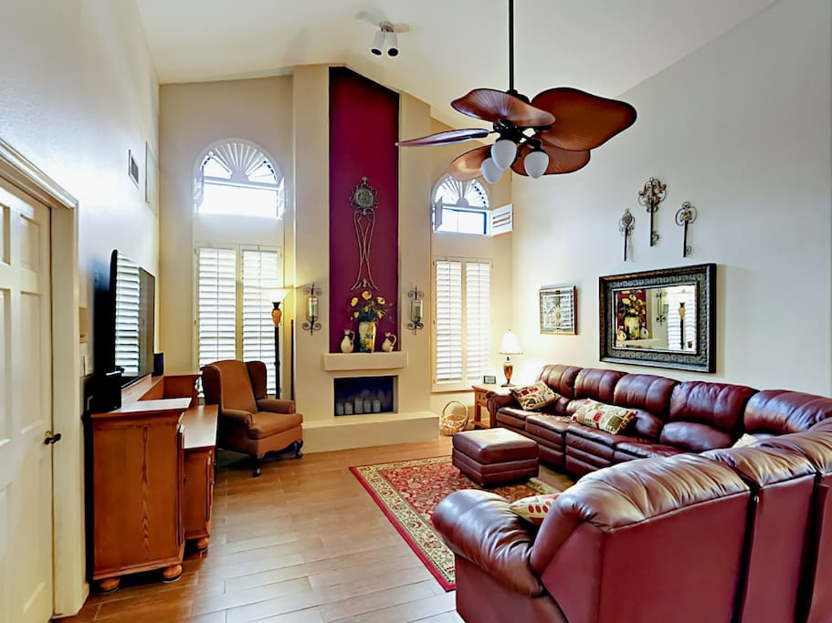 Soaring ceilings, comfy leather sofas, and tall windows in the living area.