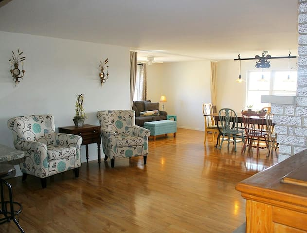 Comfortable seating between the open kitchen and dining area.