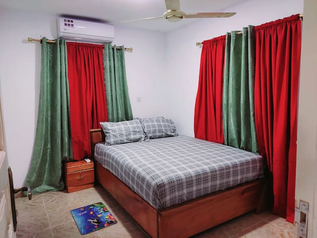 A brand new air-conditioned and a ceiling  fan bedroom with a high density orthopaedic mattress for your comfort.