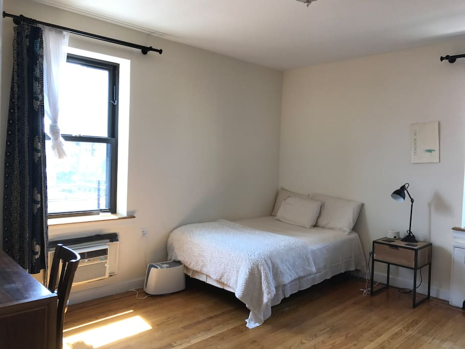 Giant bedroom, with thick drapes to block out ample sunlight from two big streets (no buildings immediately next to apartment).