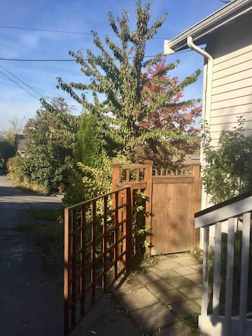 Enter side yard/private patio thru wood gate to downstairs apartment entrance