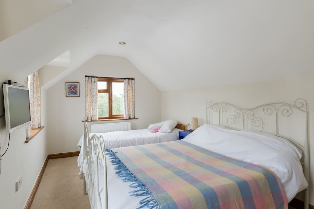 This sunny room has a king size bed and a single bed.  Ideal for families with young children or friends that are happy to share a room.