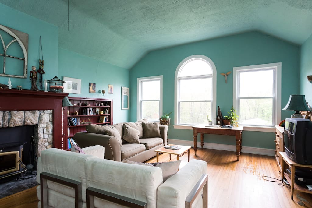 The great room with 15-foot vaulted ceilings, stone fireplace, arched doorways and windows and lots of natural light.