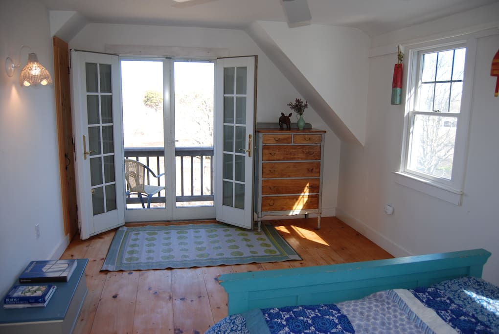 Master bedroom, balcony overlooking marsh and slight views of Stage Harbor