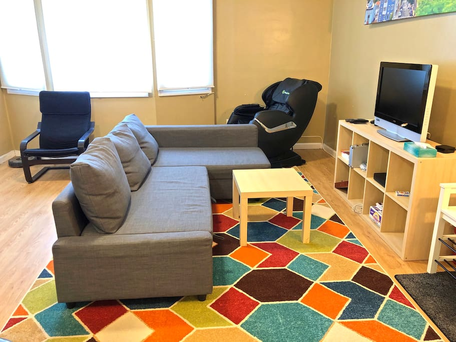 living room, with pull out couch (full size) and the massage chair