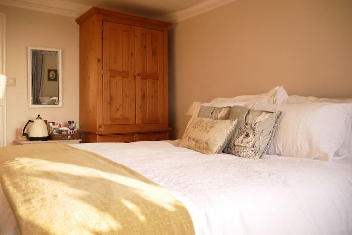 Double bed, wardrobe and tea/coffee making facilities.