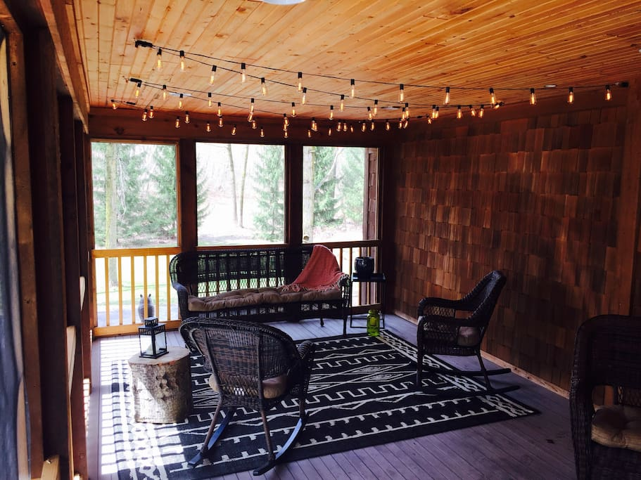 Cozy screened in porch overlooking backyard.