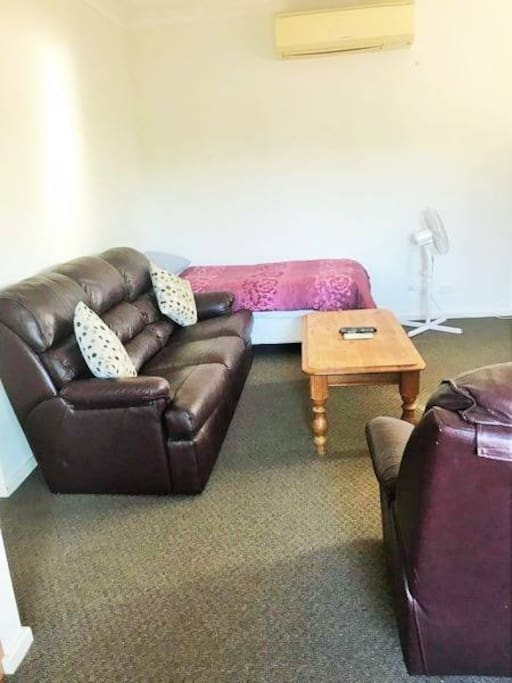 full size loungeroom addition of single bed is an option, leather lounge & recliner