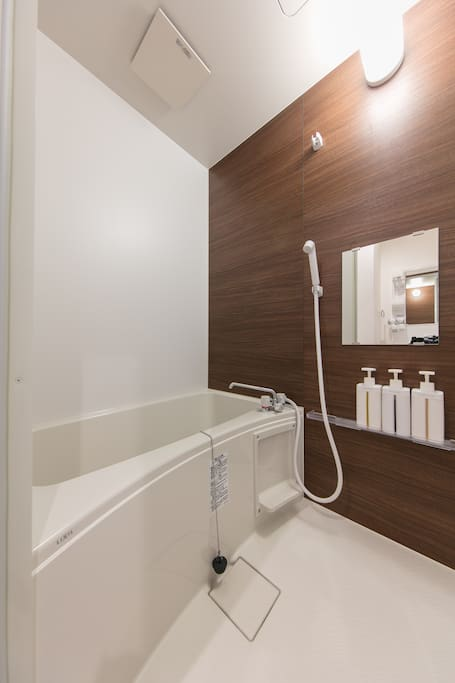 A large, beautiful room that contains both shower and tub. We also offer the amenities, Shampoo, Conditioner, Body soap, you name it. Cozy hot tub awaits!