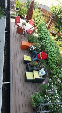 The deck and gardens off your living room