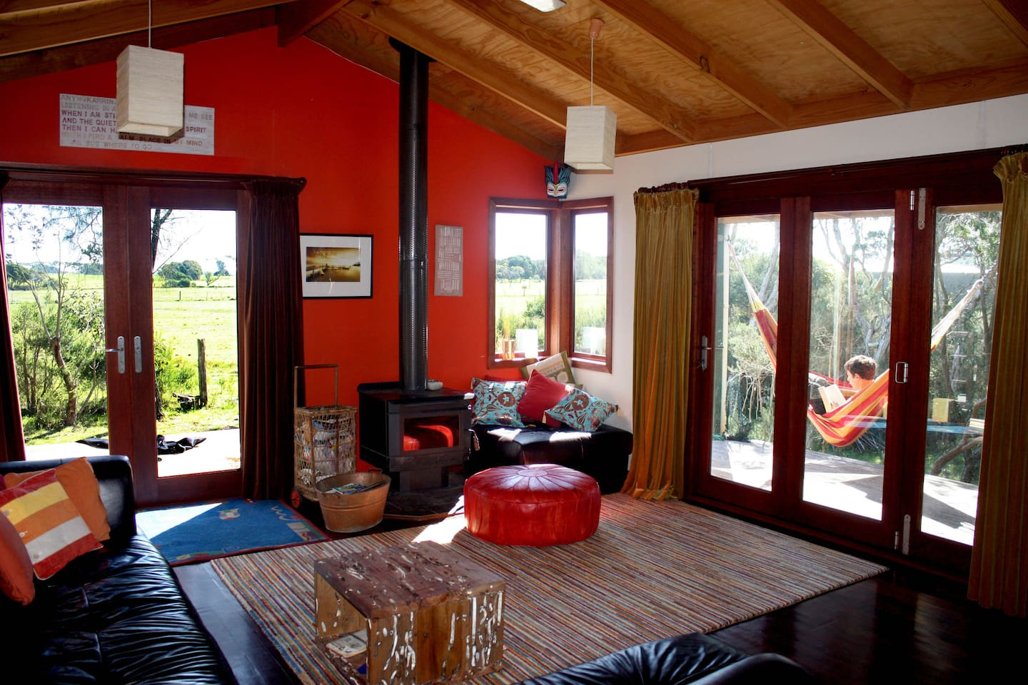 Open plan living opens out onto north and west decks surrounding by native garden setting.