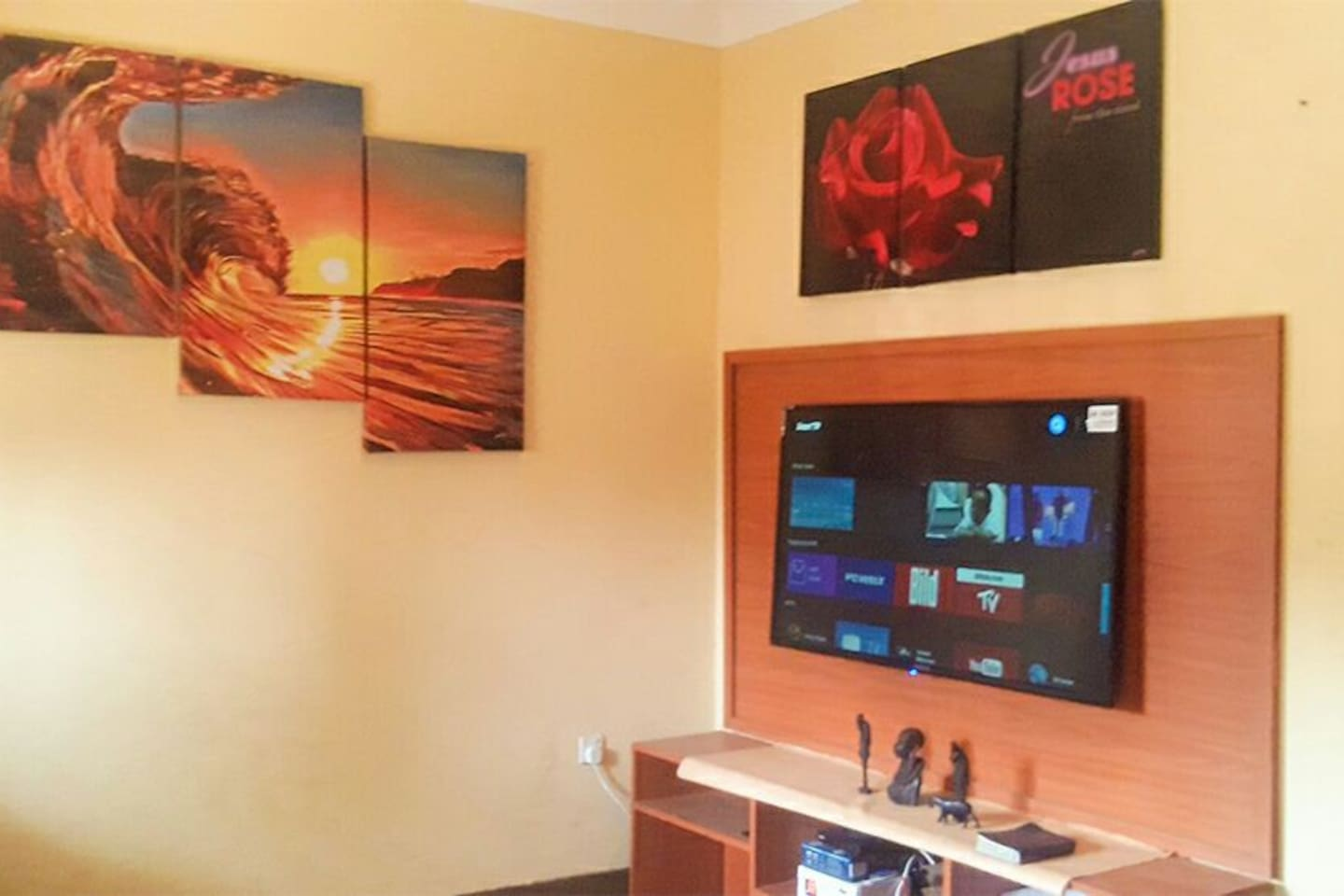 Living room with 60inch Flat screen Android Smart Tv,  Prepaid Digital Satelite Televesion,