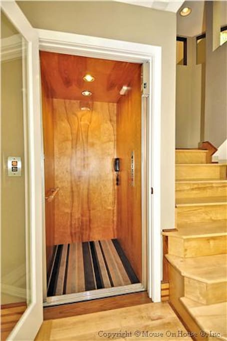 Elevator just inside the front door goes from 1st Floor to 3rd.  GREAT for getting your luggage up to the guest rooms on 3.  :-)