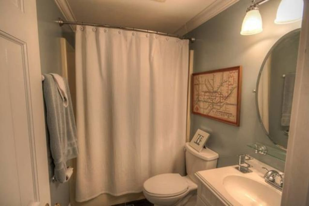 Private bathroom, with bath tub, white suite