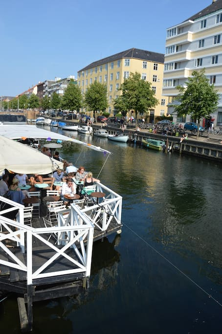 People enjoying themselves in the canal café