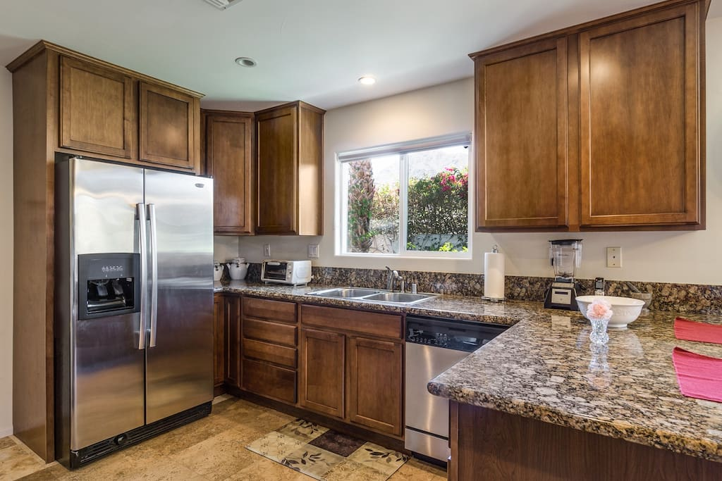 Kitchen amenities include granite countertops and full-size appliances