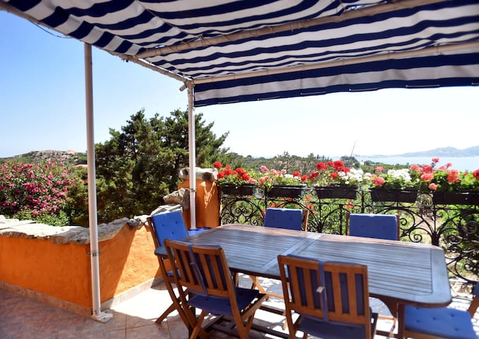 Terrace with sea view over Caprera. The table will be replaced by an extendable one (1.8-2.4m) that can accommodate 10+ people.