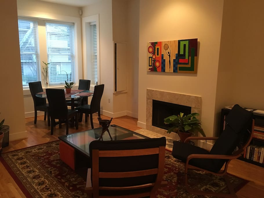 Living room and dining area. Living room features Apple TV with access to thousands of TV shows and movies.