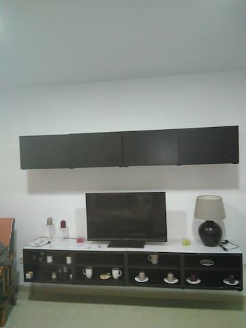 TV, Wifi y muebles salón