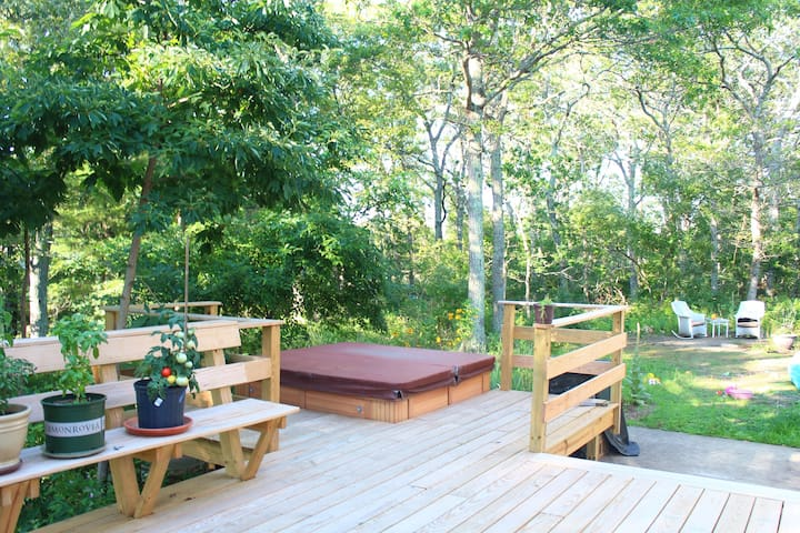 Hot tub available for use - and wraparound yoga deck that looks out at walking trails.