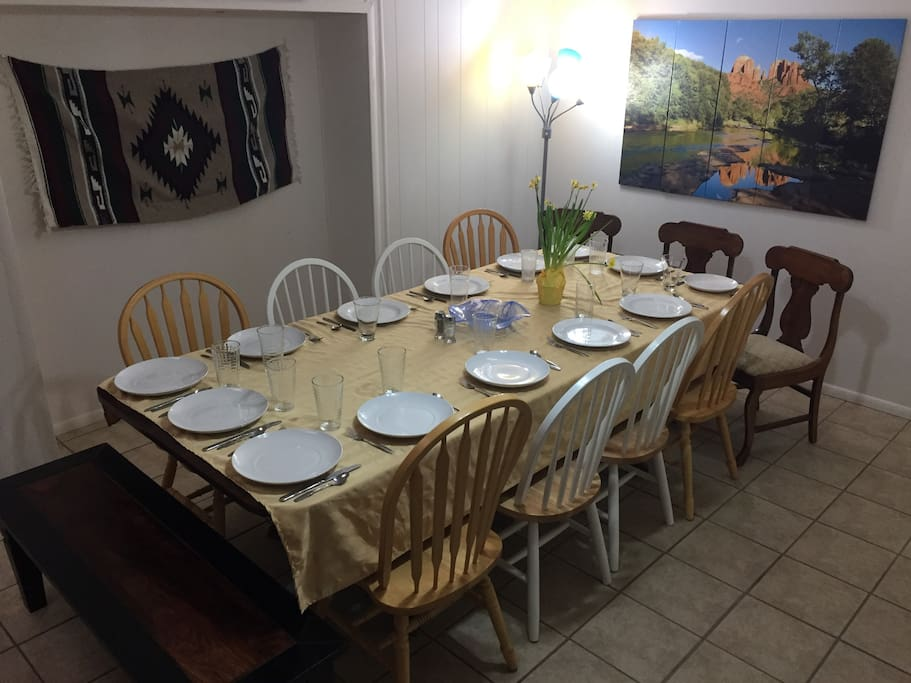 Large dining room table seats 14 comfortably! Can move breakfast nook table next to it to seat 20 together.