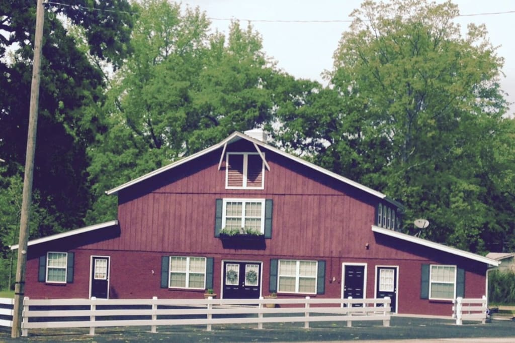 The Red Barn At Maxes Acres. Entrance to this listing is the far left front door.