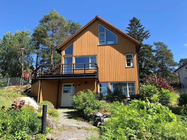 Beautiful house with a garden, view of the fjords