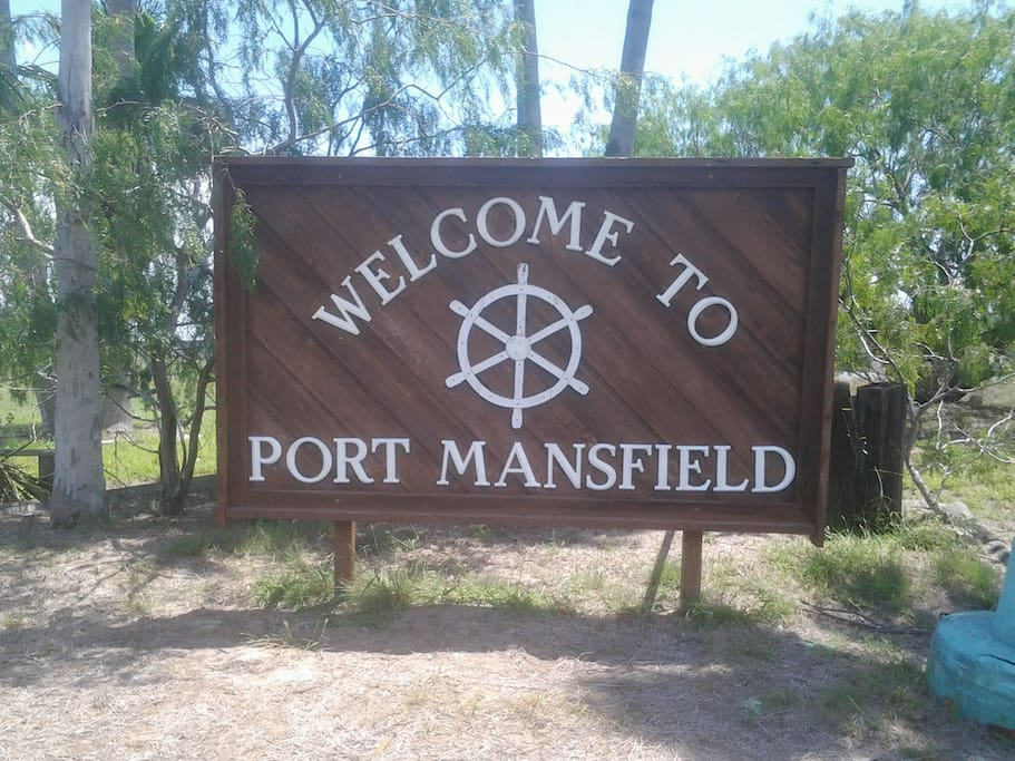 welcoming sign to Port Mansfield, TX.