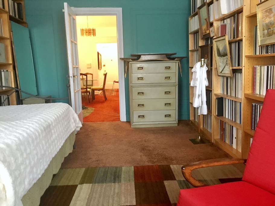 Library - bedroom. Entrance to the apartment is straight down the hall when existing room.