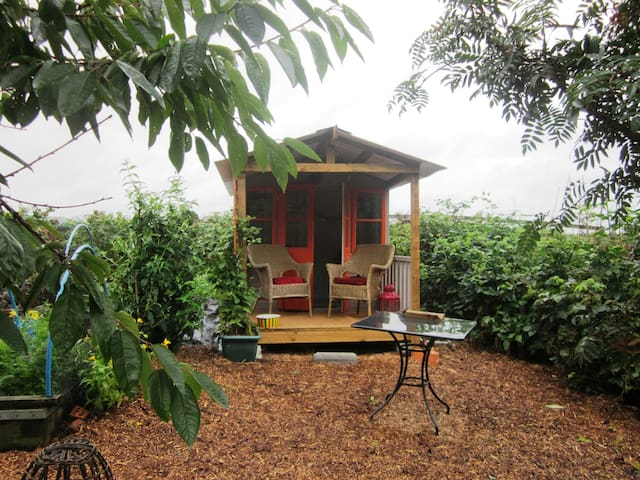 Our summer house, rain shelter and garden rest area.